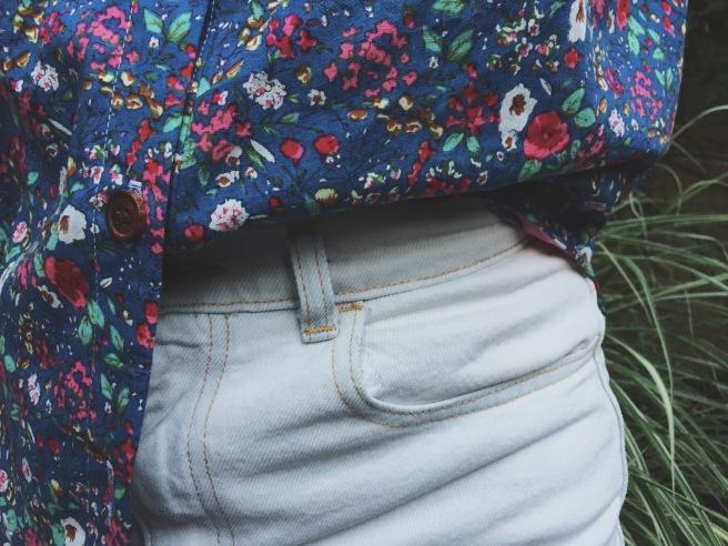 closeup of archer button up shirt, wooden buttons