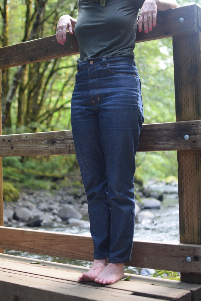 woman poses in high-waisted, rigid denim Dawn jeans