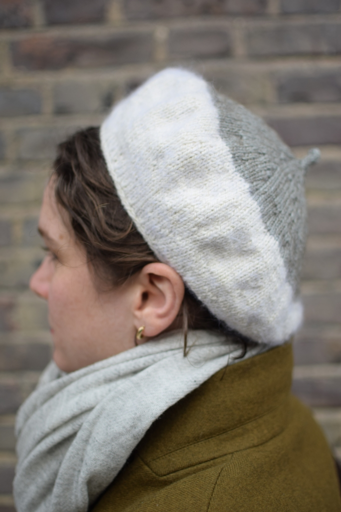 The side view of a beret.