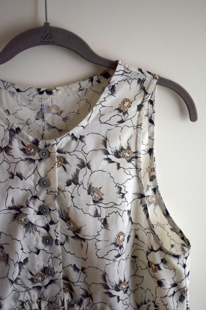 Closeup of a handmade black and white floral dress.