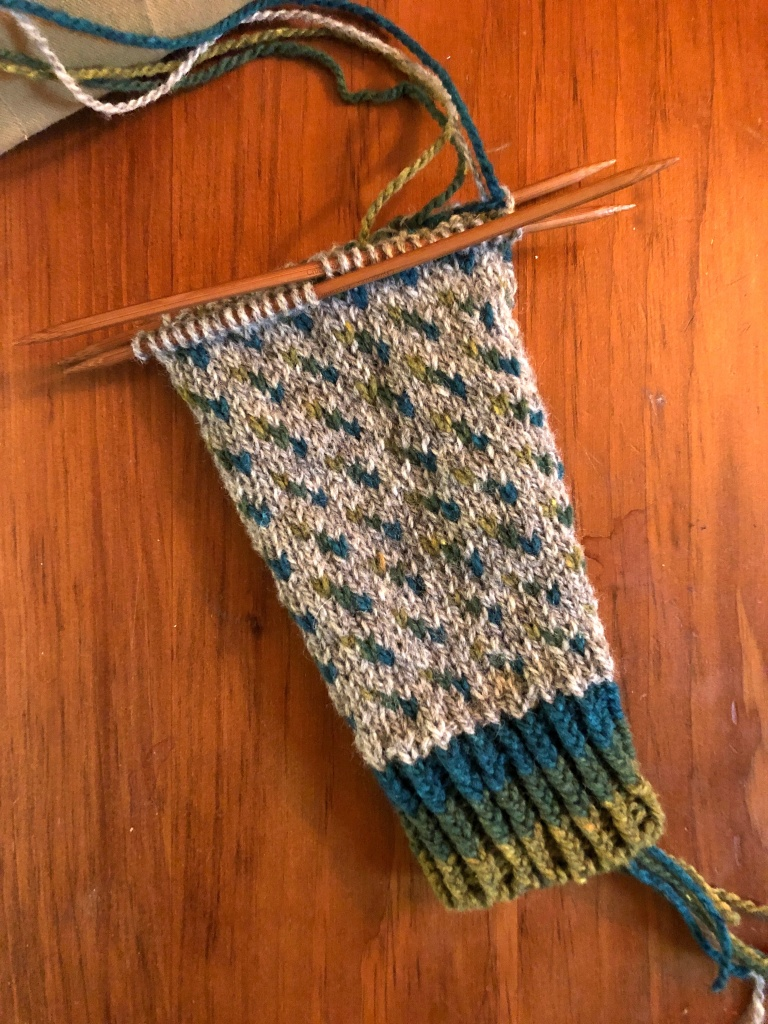 an in-progress photo of a hand knitted, allover colorwork sweater