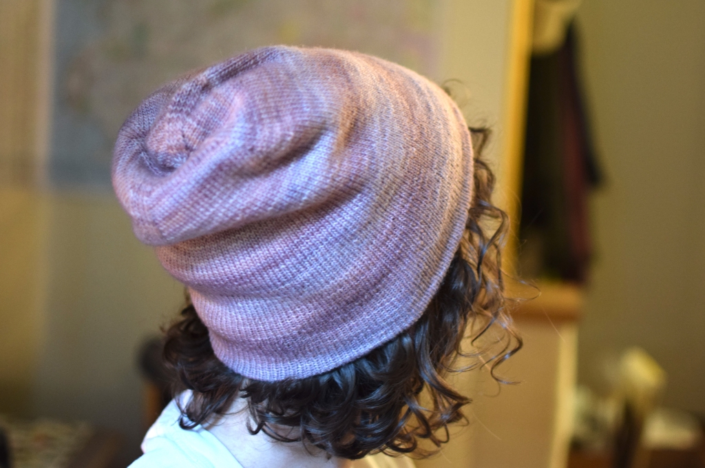 a hand-knitted pink hat.